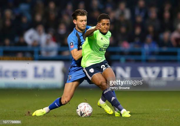 Kadeem Harris of Cardiff City is challenged by Ben Chapman of Gillingham during the FA Cup Third Round match between Gillingham and Cardiff City at...