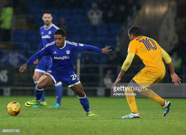 Kadeem Harris of Cardiff City is closely marked by Jermaine Beckford of Preston North End during the Sky Bet Championship match between Cardiff City...