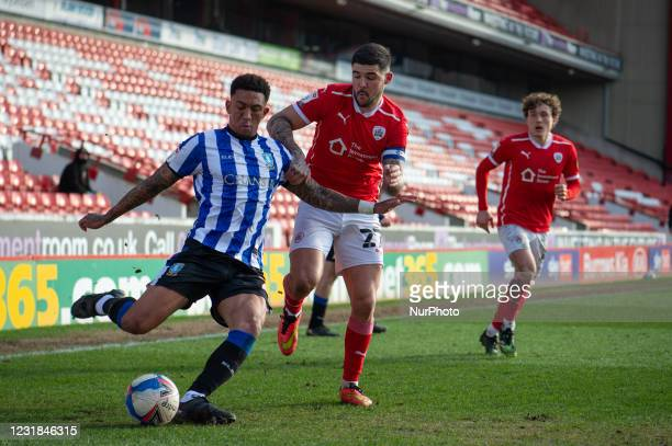 Kadeem Harris of Sheffield Wednesday crosses the ball during the SkyBet Championship match between Barnsley and Sheffield Wednesday at Oakwell,...