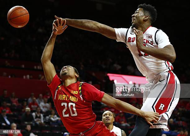 Kadeem Jack of the Rutgers Scarlet Knights knocks the ball away from Richaud Pack of the Maryland Terrapins during the first half of a college...