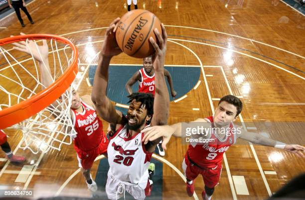 Kadeem Jack of the Sioux Falls Skyforce grabs a rebound in front of Dusty Hannahs of the Memphis Hustle during an NBA GLeague game on December 25...