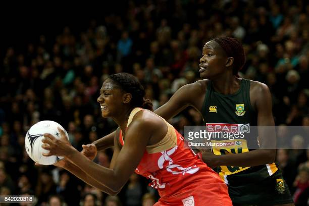 Kadeen Corbin of England gets the ball ahead of Phumza Maweni of South Africa during the 2017 Quad Series match between the England Roses and the...