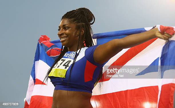 Kadeena Cox of Great Britain celebrates winning the Women's 100m T37 Final during the Evening Session on Day One of the IPC Athletics World...