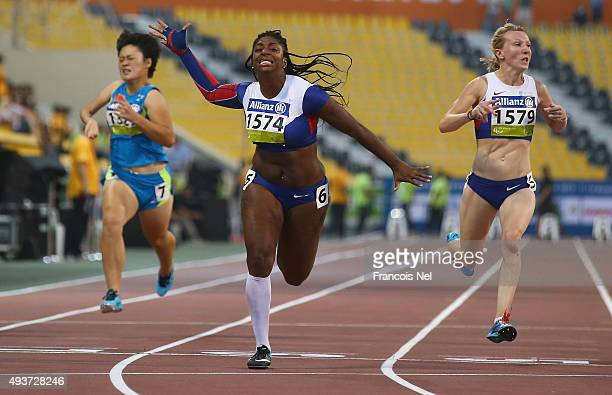 Kadeena Cox of Great Britain wins the Women's 100m T37 Final during the Evening Session on Day One of the IPC Athletics World Championships at Suhaim...