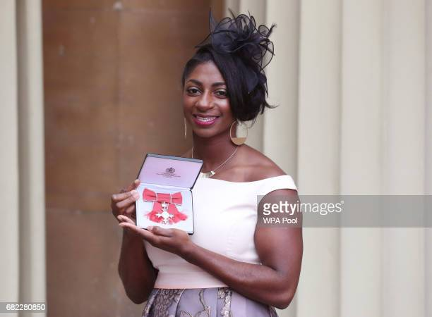 Kadeena Cox poses after she was awarded an MBE by the Duke of Cambridge during an Investiture ceremony at Buckingham Palace on May 12 2017 in London...