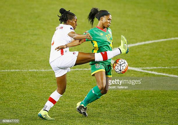 Kadeisha Buchanan of Canada battles for the ball with Otesha Charles of Guyana during the 2016 CONCACAF Women's Olympic Qualifying at BBVA Compass...