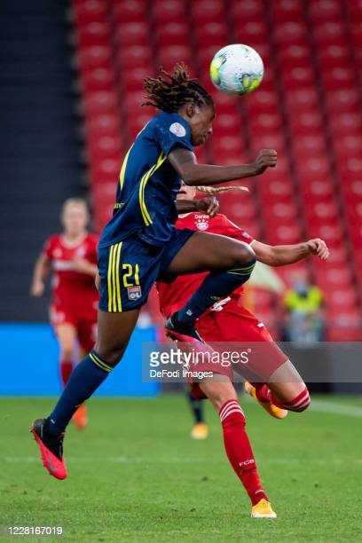 Kadeisha Buchanan of Olympique Lyon and Giulia Gwinn of Bayern Muenchen battle for the ball during the UEFA Women's Champions League Quarter Final...