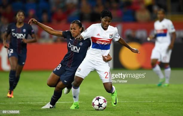 Kadeisha Buchanan of Olympique Lyonnais and MarieLaure Delie of Paris SaintGermain Feminines battle for the ball during the UEFA Women's Champions...