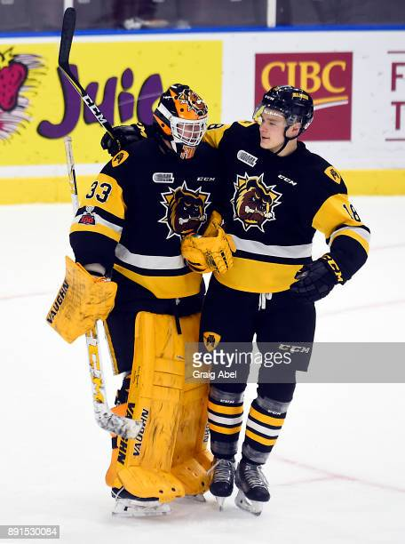 Kaden Fulcher and Matthew Strome of the Hamilton Bulldogs celebrate their team victory over the Mississauga Steelheads on December 10 2017 at Hershey...