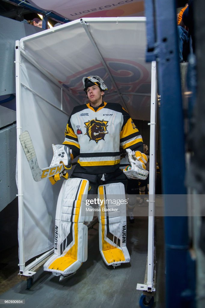 Kaden Fulcher #33 of Hamilton Bulldogs walks to the ice through the tunnel for game 1 against the Regina Pats at Brandt Centre - Evraz Place on May 18, 2018 in Regina, Canada.