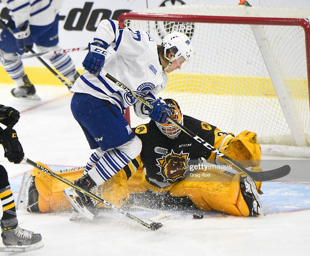 Kaden Fulcher #33 of the Hamilton Bulldogs stops a shot by Albert Michnac #77 of the Mississauga Steelheads during game action on December 10, 2017 at Hershey Centre in Mississauga, Ontario, Canada.