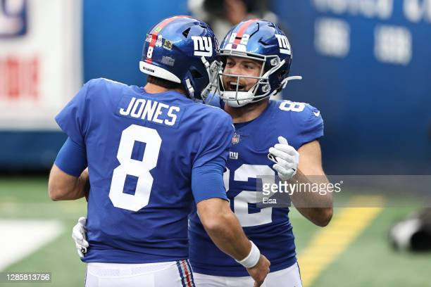 Kaden Smith celebrates with Daniel Jones of the New York Giants after Jones' touchdown during the first half against the Philadelphia Eagles at...