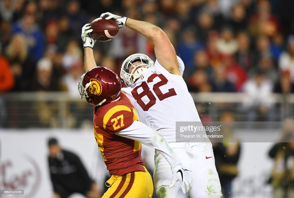 Kaden Smith #82 of the Stanford Cardinal catches a 28-yard touchdown pass over Ajene Harris #27 of the USC Trojans during the Pac-12 Football Championship Game at Levi's Stadium on December 1, 2017 in Santa Clara, California.