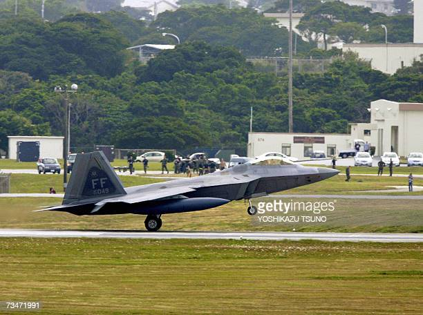 A new stealth fighter F22A Raptor arrives at Kadena Air Base in Kadena town southern island of Okinawa 17 February 2007 Two US air force F22A stealth...