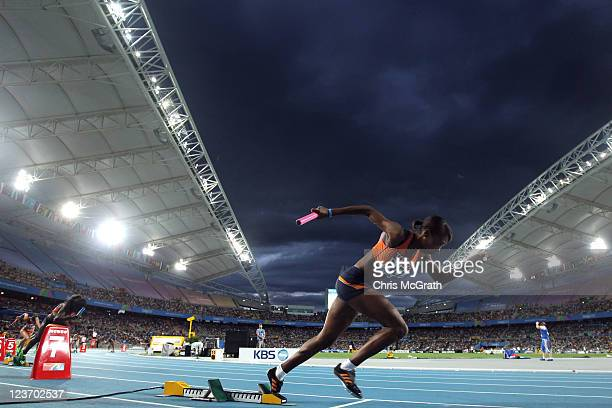 Kadene Vassell of Netherlands bursts out of the starting blocks at the start of the women's 4x100 metres heats during day nine of the 13th IAAF World...