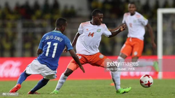 Kader Aboubacar of Niger is challenged by Vinicius Jr of Brazil during the FIFA U17 World Cup India 2017 group C match between Niger and Brazil at...
