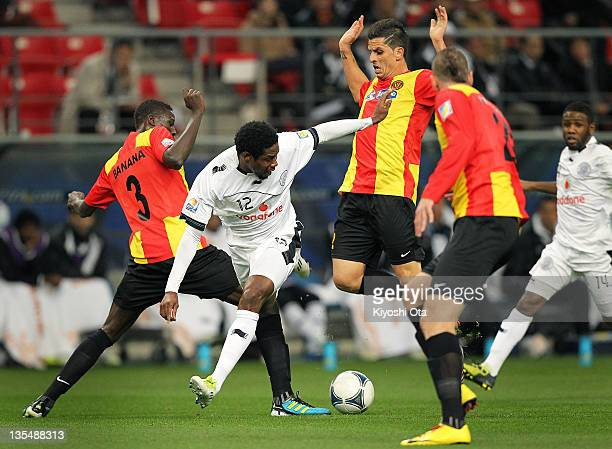 Kader Keita of AlSadd is challenged by the Esperance Sportive de Tunis players during the FIFA Club World Cup Quarter Final match between Esperance...