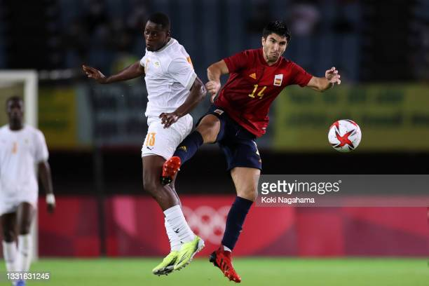 Kader Keita of Team Ivory Coast heads the ball with Carlos Soler of Team Spain during the Men's Quarter Final match between Spain and Cote d'Ivoire...