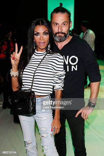 Kader Loth and Tobias Bojko attend the Emre Erdemoglu show during the MercedesBenz Fashion Week Berlin Spring/Summer 2016 at Brandenburg Gate on July...