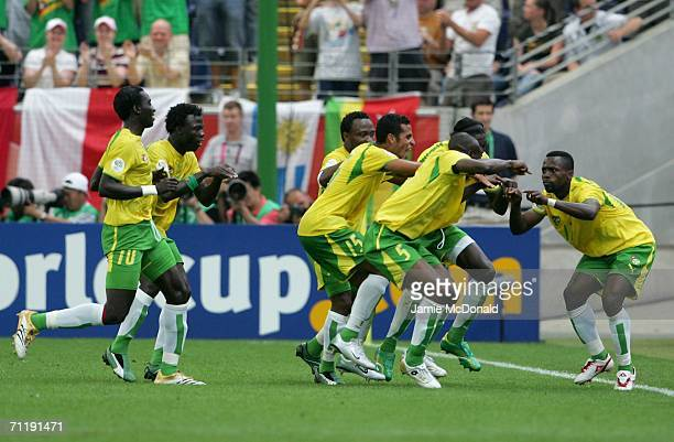 Kader Mohamed of Togo is congratulated by team mates after scoring the opening goal during the FIFA World Cup Germany 2006 Group G match between...