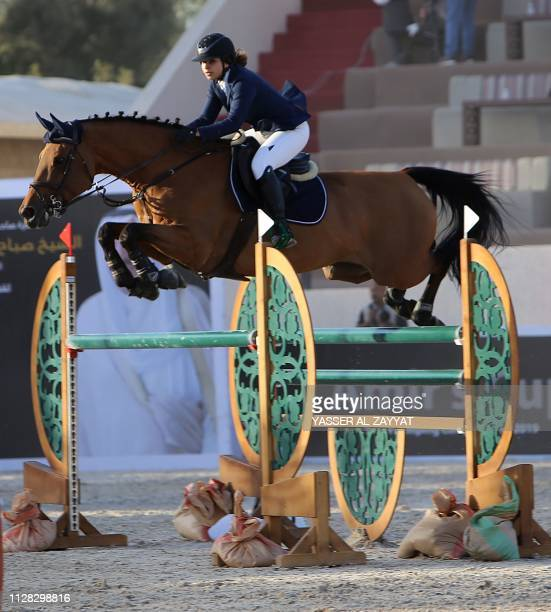 Kadi alMarshoud rides a horse over a hurdle during the Emir's Cup horse jumping competition in Kuwait City on March 1 2019