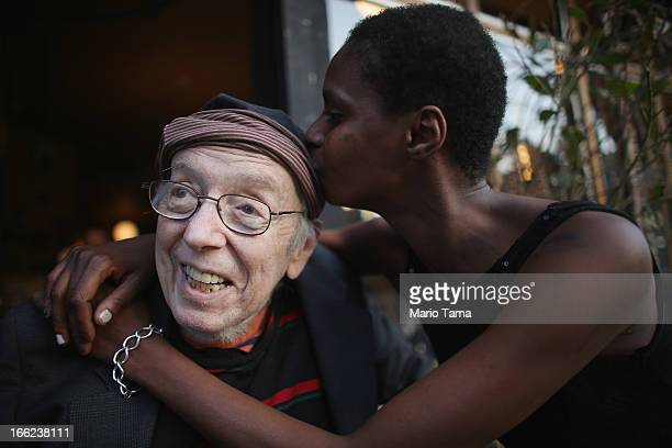 Kadia Sy kisses Taylor Mead an iconic Beat generation poet and star of films by Andy Warhol and others while posing at a gathering of friends on the...