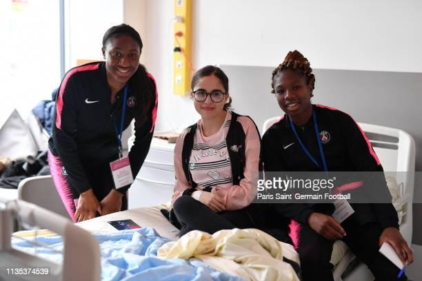 Kadidiatou Diani and Aminata Diallo pose with Lilia at Necker Hospital on March 12 2019 in Paris France