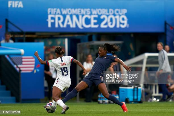 Kadidiatou DIani of France battle for the ball with Crystal Dunn of USA during the 2019 FIFA Women's World Cup France Quarter Final match between...