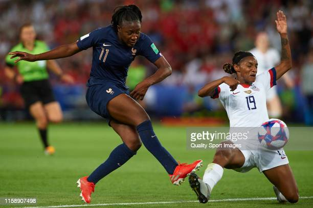 Kadidiatou DIani of France competes for the ball with Crystal Dunn of USA during the 2019 FIFA Women's World Cup France Quarter Final match between...