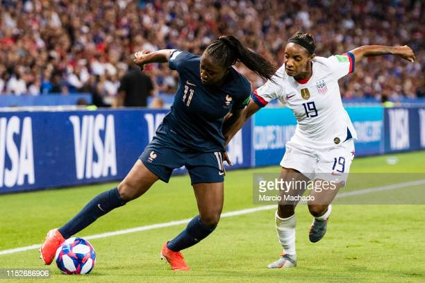 Kadidiatou Diani of France fights for the ball with Crystal Dunn of United States during the 2019 FIFA Women's World Cup France Quarter Final match...