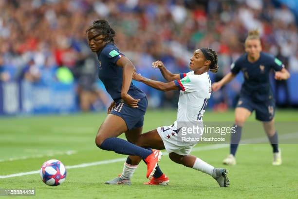 Kadidiatou Diani of France is put under pressure by Crystal Dunn of the USA during the 2019 FIFA Women's World Cup France Quarter Final match between...
