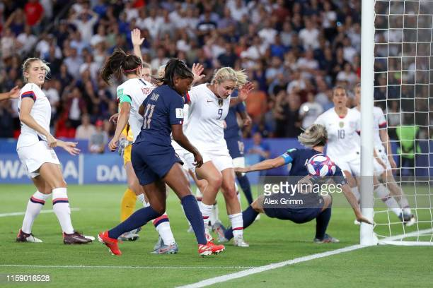 Kadidiatou Diani of France misses a chance to score under pressure from Lindey Horan of the USA during the 2019 FIFA Women's World Cup France Quarter...