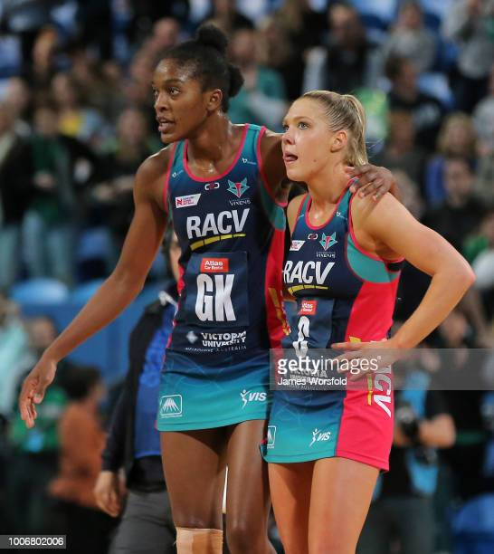 KadieAnn Dehaney of the Melbourne Vixens and Kate Moloney of the Melbourne Vixens look on after being defeated by the West Coast Fever during the...