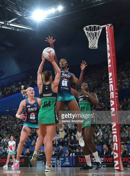KadieAnn Dehaney of the Melbourne Vixens tries to block a goal attempt by the fever during the round 13 Super Netball match between the Fever and the...