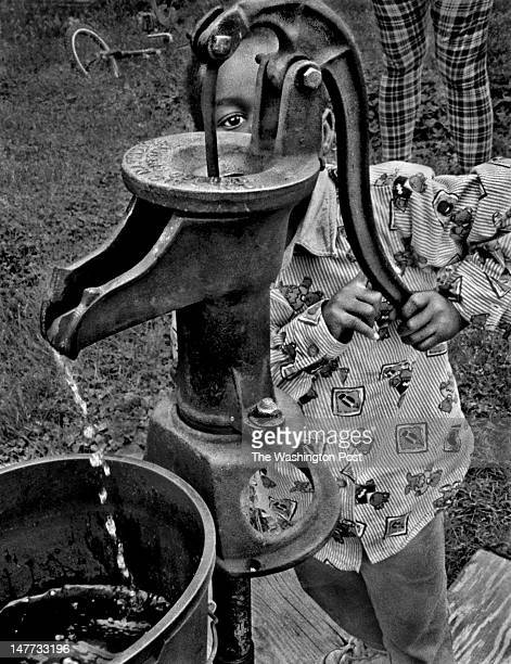 FILE Kadijah Cummings pumps water from the community well in Bayview Virginia on May 9 1998 The town has no running water and the pumped water tastes...