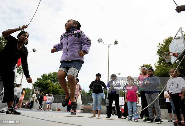 Kadijah Drummond takes part in the Jump Into Peace at Washington Park on September 13 2014 during a Double Dutch themed block party for the whole...