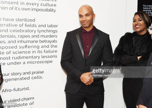 Kadir Nelson and Jazmine Sullivan attend HBO's The HeLa Project Exhibit For The Immortal Life of Henrietta Lacks on April 6 2017 in New York City