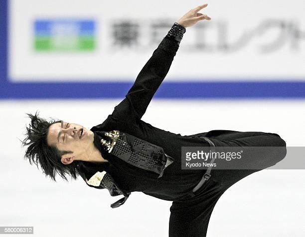 Kadoma, Japan - Daisuke Takahashi performs in the men's free skate during the national figure skating championships at the Namihaya Dome in Osaka...