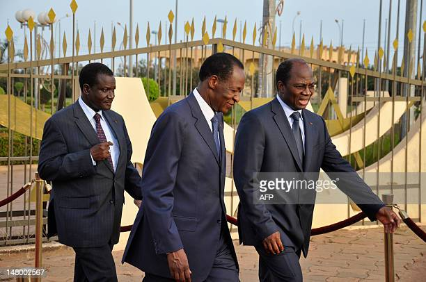 Kadre Desire Ouedraogo president of the Economic Community of West African States commission ECOWAS top mediator and Burkina Faso's President Blaise...