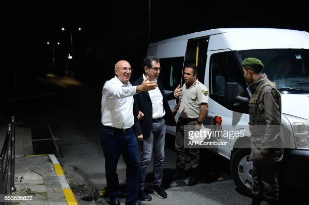 Kadri Gursel is welcomed by main opposition Republic People's Party member of parliament Mahmut Tanal after being released from Silivri prison on...