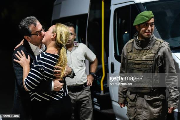 TOPSHOT Kadri Gursel kisses his wife after his release from Silivri prison on September 26 2017 in Istanbul following a Turkish court order to free...