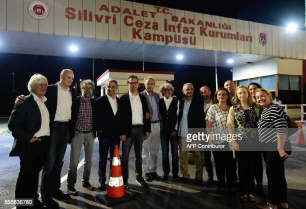 Kadri Gursel poses for a picture with his wife and friends after his release from Silivri prison on September 26 2017 in Istanbul following a Turkish...
