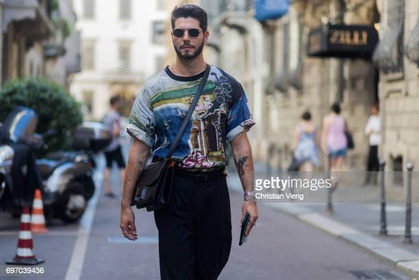 Kadu Dantas is seen outside Versace during Milan Men's Fashion Week Spring/Summer 2018 on June 17 2017 in Milan Italy