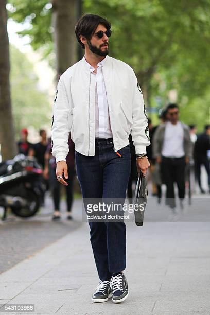 Kadu Dantas is wearing a Dior full outfit, before the Balmain show, during Paris Fashion Week Menswear Spring/Summer 2017, on June 25, 2016 in Paris,...