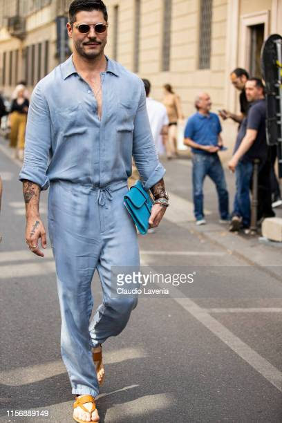 Kadu Dantas wearing a light blue jumpsuit teal purse and tan sandals is seen outside Giorgio Armani show during the Milan Men's Fashion Week...