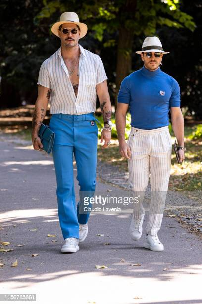 Kadu Dantas wearing a white and light blue shirt light blue pants white shoes straw hat and blue bag and Peter Zawel wearing a blue Prada turtleneck...