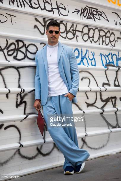 Kadu Dantas wearing Acne Studio white t shirt and light blue suit is seen in the streets of Paris before the Acne Studio show during Paris Men's...