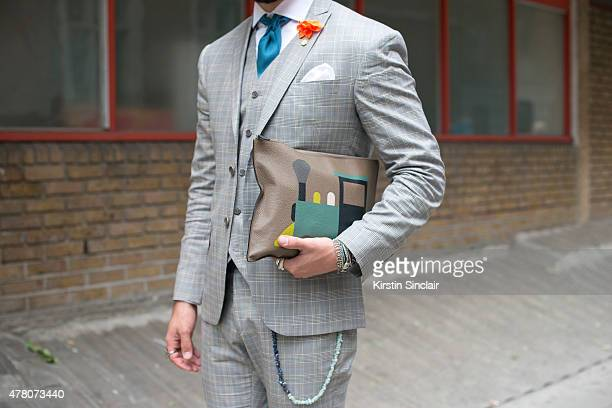 Kadu Dantas wears Ricardo Almeida suit Dudalina shirt Hermes tie Moynat bag  on day 1 of bda3d67fa09