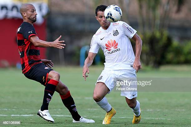 Kadu of Vitoria battles for the ball with Leandro Damiao of Santos during the match between Vitoria and Santos as part of Brasileirao Series A 2014...
