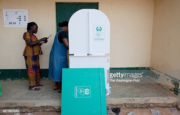 A woman casts her vote at a polling station in Kaduna Nigeria on Saturday March 28 2015